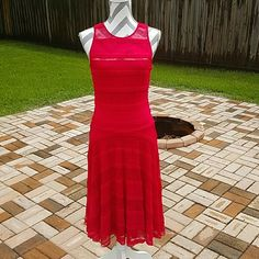 Red Lace Dress Gorgeous dress! Red lace. Tea length. NWT! The 3rd pic is a pic of me wearing the dress, however it is a size or 2 too big for me & would look much more flattering on someone who it fits how it's supposed to. Sangria Dresses Midi