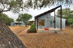 Affordable gestures abound in this transformation of a dilapidated former duplex in the Texas Hill Country. For a cost-conscious 2,000-square-foot renovation located 30 minutes outside of Austin, Texas, architect Nick Deaver took a look around for inspiration. He spied galvanized metal cladding on the region's sheds and co-opted the inexpensive, resilient material for his own design. He then applied locally quarried Lueders limestone