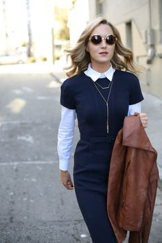 Adding an edgy, retro twist to a classic look with this navy sheath dress and leather moto jacket. Perfect for work or play!
