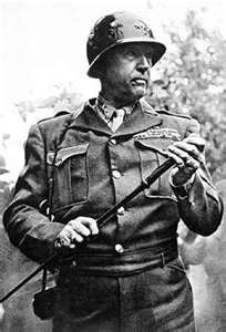 Gen. George S. Patton. They called him old blood and guts. Judging by the look in his face he's out to find some more blood and guts. Because as we all know, George  Patton lived for such things.