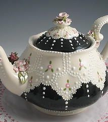 What a pretty tea pot! It reminds me of a black dress and pearls!
