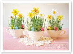 Cute idea for mismatched teacups then a name tag or place holder at a easter dinner. I would maybe use a few cut flowers though too instead of the paper ones.
