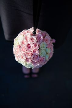 Instead of getting bouquets for your bridesmaids try a flower ball.  They hold up much better over the day. Brittany and Jamahl's Wedding at the Liberty Hotel in Boston » Fuccis Photos of Boston–Something Blue Blog | Boston Wedding Photographer  Image by Vail Fucci