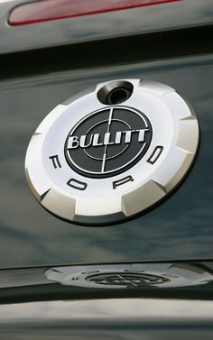 "In 2008, Ford came out with a special Mustang Bullitt edition in celebration of the 40th anniversary of the 1968 film, Bullitt. Exterior features include uniquely finished 18"" Torq-Thrust style wheels and removal of the decklid spoiler and all badges except for the faux gas cap, which is replaced with a Bullitt-specific unit. A unique exhaust mimics the sound of Steve McQueen's GT 390 Fastback."