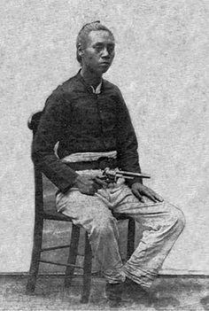 Satsuma samurai holding a revolver.