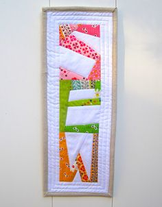 "Paper pieced ""SEW"" banner to hang in my sewing/quilting room."