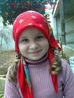 """She looks so serene, so cheery and full of life, with her red scarf …    Like little Lily with the red hood, who met the wolf. But here, in Idlib, it was not a wolf .. It was the ugliest monster.    Assad yet again, killed another Syrian smile.    Martyr """"Nour Abdulwahab Dayoub"""", Idleb - Khan Sheikhoun"""