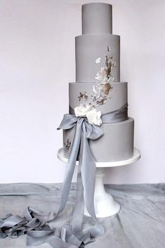 Gold Wedding Cakes wedding colors 2019 grey tall bridal cake with ribbons and gold foil wildflower_cakes - In wedding colors 2019 inspirational gallery you will find trendy color ideas and choose the one that fits the mood you want to set. Elegant Wedding Cakes, Beautiful Wedding Cakes, Wedding Cake Designs, Wedding Cake Toppers, Beautiful Cakes, Trendy Wedding, Silver Wedding Cakes, Gray Wedding Cakes, Silver Cake