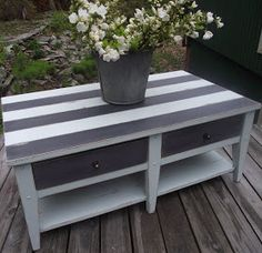 Striped coffee table - fun way to bring in pattern and color  Serendipity Chic Design. Definately on my challenge list