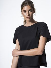 I love it!!! I love the entire collection! With modern cuts at the hemline and sleeves, the Hudson by Carbon38 allows for unencumbered movement in a structured top. A fitted design and premium stretch fabric contour the body without compromising figure.CARBON38 MET COLLECTION Hudson Black SHORT SLEEVE TEES #ad #women #fashion #blac #tees #elegant #spring #summer
