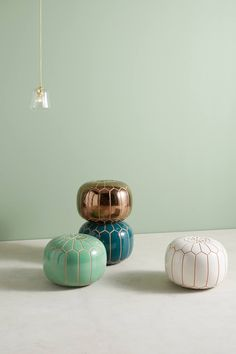 Interesting trompe l'oeil take on a traditional Moroccan pouf - Ceramic stool/end table replacement