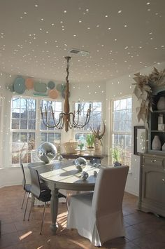 Use disco balls as decorative accessories that also scatter points of light around the room