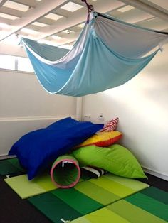 lycra and giant bean bags and crash mats used to create a tunnel hut