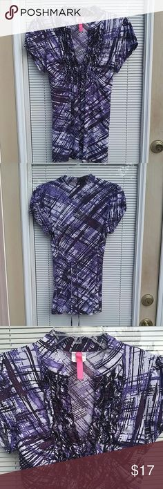 Sexy purple top Purple and black top with ruffles around neckline. Flattering form fitting around bust. Gently worn. No wear or tear. Great condition. HeartSoul Tops