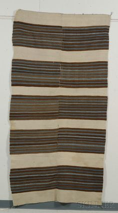 Rio grande weaving woven in two pieces with concentric serrate diamond center striped ends and multicolored banded design 69 x 40 in Indian Blankets, Navajo Rugs, Upholstered Ottoman, Striped Rug, Yellow Stripes, Rio Grande, Stripes Design, Oriental Rug, 19th Century