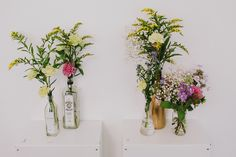 Gin Bottle Vases with Flower Stems | The Art Pavilion in London | Gin Theme | Bloom Weddings | http://www.rockmywedding.co.uk/katie-adam-2/