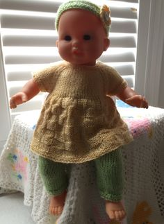 "Easy, cute design done on straight needles for 14"" baby doll. http://www.ravelry.com/patterns/library/basket-weave-dress-leggings-headband-for-14-doll"