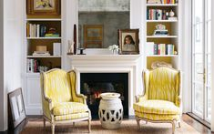 Susan Greenleaf's mother, of Dutch heritage, is pictured at age four or five in an oil painting on the mantel. The yellow-and-white upholstery on the armchairs is a Christopher Farr fabric sourced through De Sousa Hughes. | Lonny