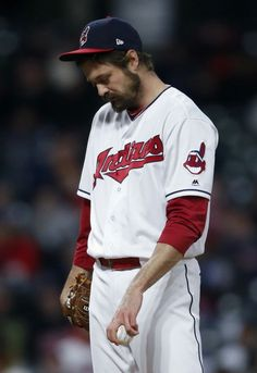 Cleveland Indians' Andrew Miller reacts after having thrown only two pitches against the Chicago Cubs during the seventh inning in a baseball game Wednesday, April in Cleveland. Miller had to leave the game.