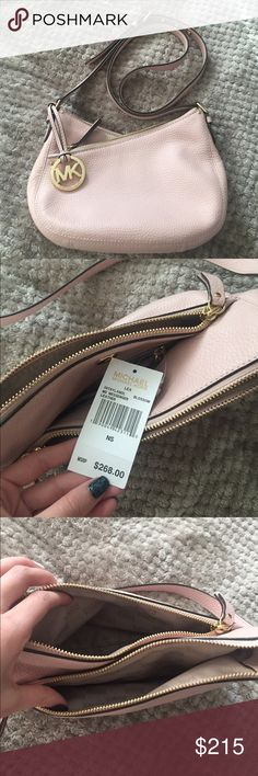 Michael Kors Lea Messenger Bag Genuine leather Michael Kors messenger bag in color blossom. Never used and like new condition. NWT. Taking reasonable offers:) doesn't come with original dustbag, but am throwing in a fashionphile one Bags Crossbody Bags