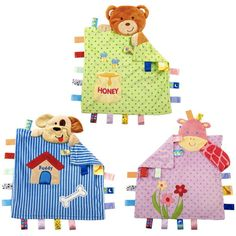 Regalo original para bebés, una mantita llena de etiquetas para que muerda y se entretenga. Original manta para bebé con alegres colores, formas y texturas.