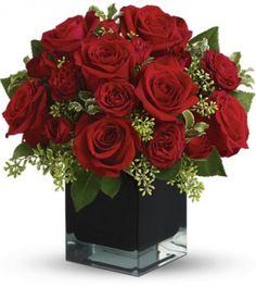 red roses in black vase