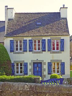 French home with Blue Shutters and Two Chimneys