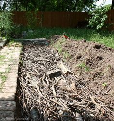 What Is Hügelkultur? Build healthy soil your garden can rock out in with this German compost technique. Photo courtesy Jon Roberts/Wikimedia (HobbyFarms.com)