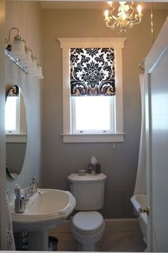 Art Exhibition Blinds Premier Roman Shades can give you a very similar look to these bathroom