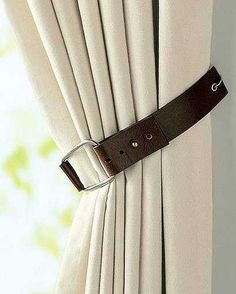 Curtain holder made with a sturdy leather belt