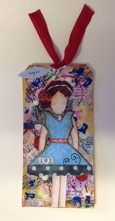 Inspired by tutorials by Christy Tomlinson I created this mixed media tag using scraps of card stock, music paper, twinkling H2O's, acrylic paint and stamps. More info on my blog freddietoledo.blogspot.com.
