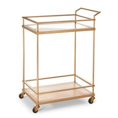 Party long and prosper with a Threshold Bar Cart in gold. Ideal for entertaining, this bar cart lets you move drinks and appetizers to wherever your guests congregate. It has 2 shelves for holding beverages, snacks and more. Both shelves have railings to prevent items from sliding off. This serving cart rolls on 4 durable wheels, making it easy to cart from room to room. Plus, it's made of sturdy metal with a gold finish and wood with a light, natural veneer for a chic look that matches ...