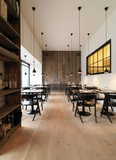 Pendants against white walls + dark tables/chairs.
