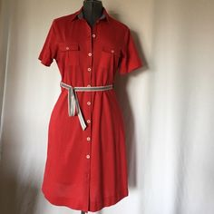 "Cotton button down shirt dress NWT,belted,two sides pocket, made in Morocco,100% Cotton. Adorable dress for summer. Fits best to sizes 12-14 or in between.Length 40"" Mango Dresses"