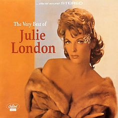 I just used Shazam to discover Cry Me A River by Julie London. http://shz.am/t3179528