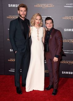 "Actors Liam Hemsworth, Jennifer Lawrence, and Josh Hutcherson attend the premiere of Lionsgate's ""The Hunger Games: Mockingjay - Part 2"" at Microsoft Theater on November 16, 2015 in Los Angeles, California."