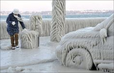 Lake Geneva Ice Storm 2-6-12 A woman walks by an ice-covered car on the iced waterside promenade at Lake Geneva in Versoix, Switzerland. Description from pinterest.com. I searched for this on bing.com/images