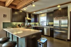 This newly-built modern and eco-friendly house has exposed wood beams, metal railings, and heated concrete and bamboo floors. The chef's kitchen isn't so bad either — there's a five-burner gas range, granite countertops, stainless steel appliances, and sleek, dark cabinetry. Rate: $275/night   - HouseBeautiful.com
