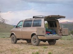 One year ago I was inflicted with the camper van flu thanks to a friend with a Westy Camper. I didn't have the cash for VW Syncro Westy nor a Sportsmobile. Van Conversion For Camping, Camper Conversion, Van Camping, Chevy Astro Van, Chevrolet Astro, Chevy Van, Car Camper, Camper Van, Campers