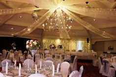 Airth Castle; white organza ceiling swags with fairy lights.  www.zenith-events.co.uk