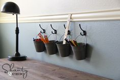Organize Kids Art Supplies....love this idea and I have some of these buckets and spray paint so all I would need is the hooks!!!!