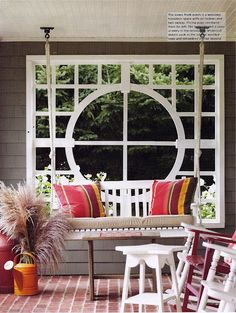 love the custom designed trellis window and the porch swing