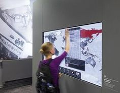 A visitor browses through interactive displays at the International Newspaper Museum in Aachen
