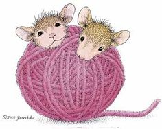 House Mouses rolling in a ball of yarn.