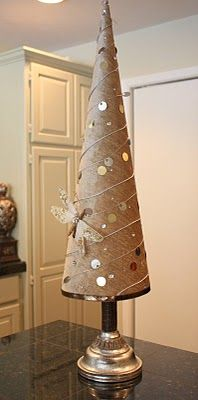 fabric covered poster board Christmas Tree cones. I think this would also work with wrapping paper instead of fabric.