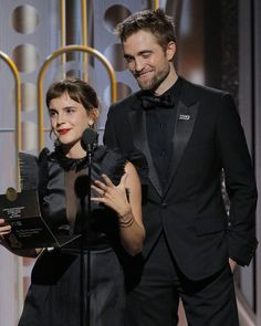 You see: Emma Watson & Robert Pattinson presenting at the #GoldenGlobes.  We see: A Harry Potter reunion. ❤️ Link in bio for more on this story! (📷: Getty Images)