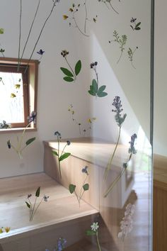 Delicate flowers –Akebi, viola, anemone, geranium and larkspur – collected from the surrounding area are pressed in a resin film between two thin sheets of glass that make up the doors. The flowers were treated with ultraviolet light to prevent discolouration.