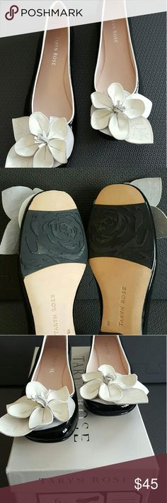 Taryn Rose Flat shoes Black and white Taryn Rose shoes. Patent black flat shoes with a beautiful white rose in the front. Very comfortable and chic. Wore a few times, but still in great condition.  They come with box. Taryn Rose Shoes Flats & Loafers