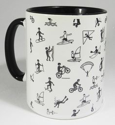 Boys and their Toys Extreme Sports Mug with glazed black handle and inner from Half a Donkey. Featuring cartoon figures of young men bungee jumping, water skiing, skiing, diving, surf boarding, rock climbing and more. Designed and printed in Britain. A high quality ceramic mug which is dishwasher proof. Height is 9.5cm, diameter 8.2cm, with a capacity of 310 ml (11oz). From the Series 1 Original Line from Half a Donkey