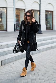 Julietta Kuczyńska wears a punky black shearling jacket over leather leggings, paired with classic Timberland boots. Blouse: Vintage, Coat: Stradivarius, Vest: Zara, Boots: Timberland.